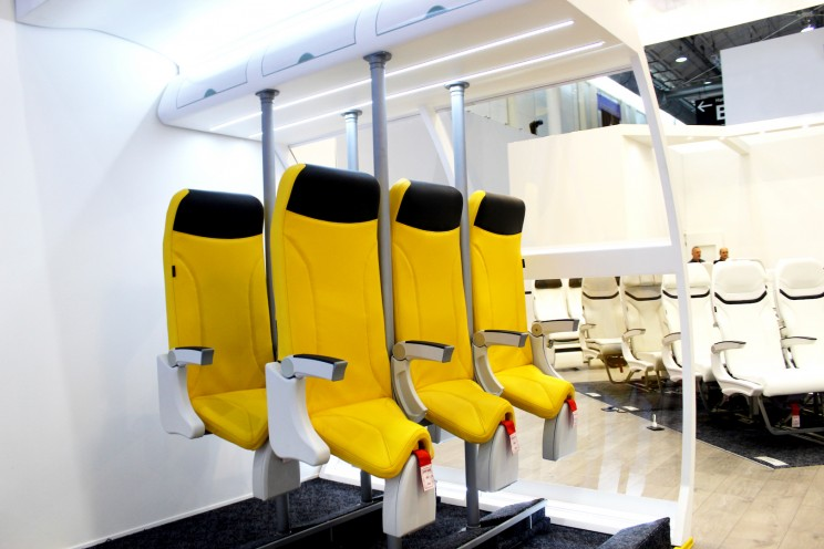 These Standing-Up Airplane Seats Are Designed to Make Flying Cheaper