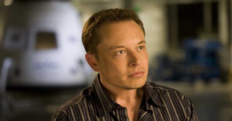 Musk Defends Tesla Work Methods to Huffington Founder Using Bankruptcy Facts