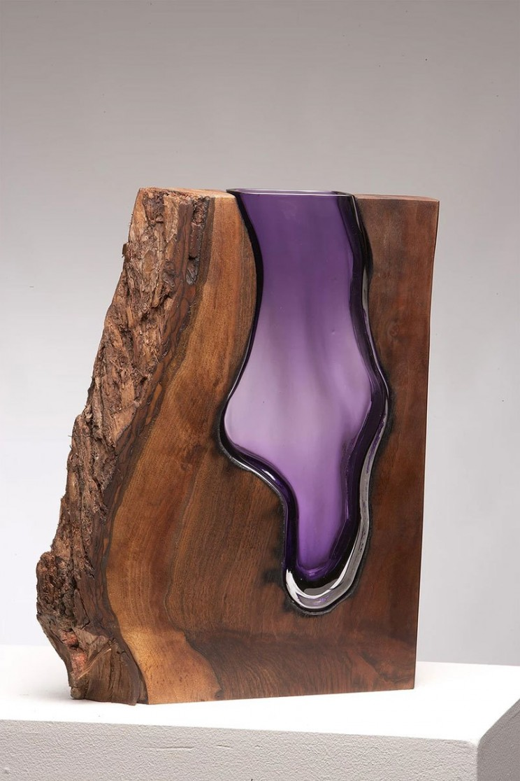 Glass Blower Achieves Stunning Results by Pouring Glass into Wood Slabs