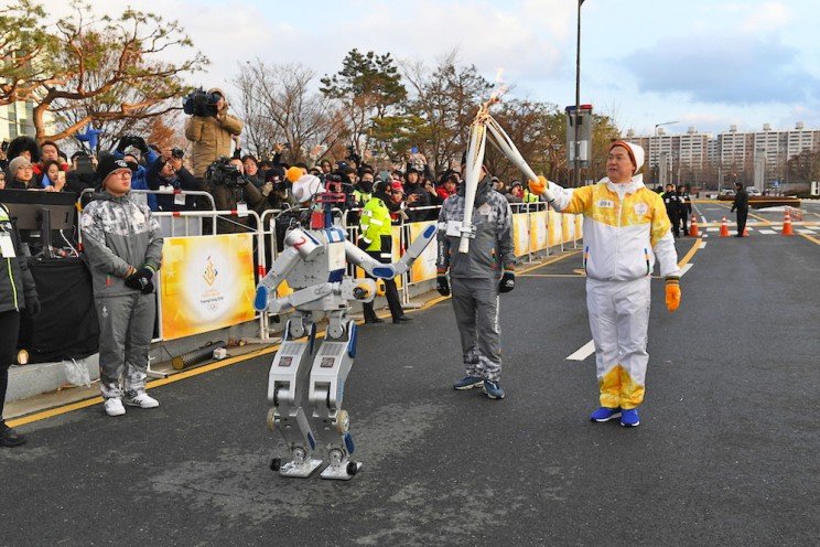 A Robot Broke Through a Wall to Deliver the Olympic Torch in South Korea