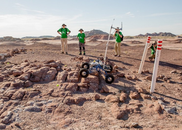Rover climbs hill above Mars Desert Research Station in Mars Society University Rover Challenge