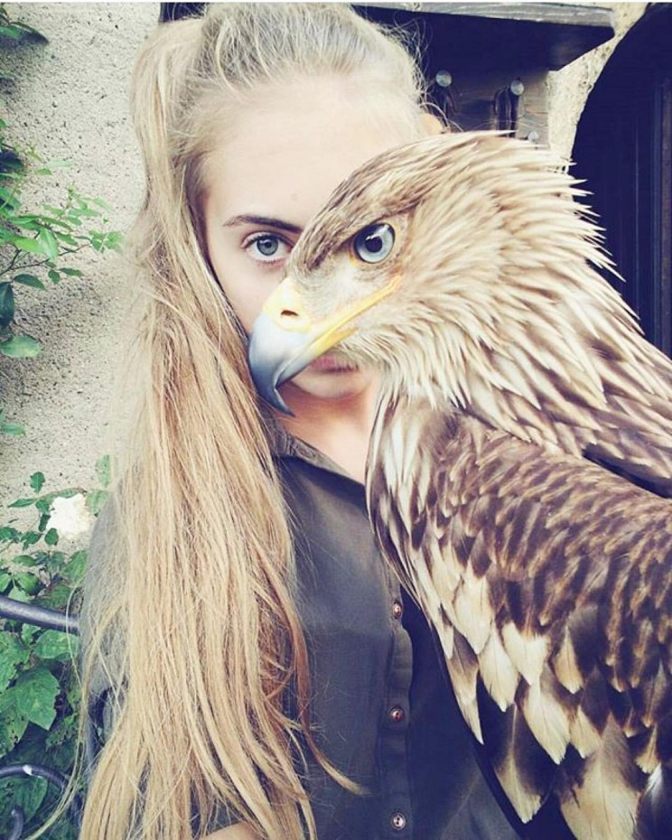 Amazing well timed photo of girl with eagle