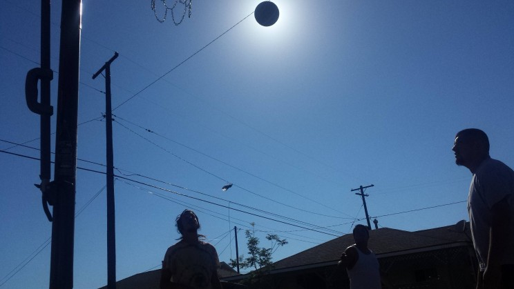 Perfectly timed photo of basketball solar eclipse