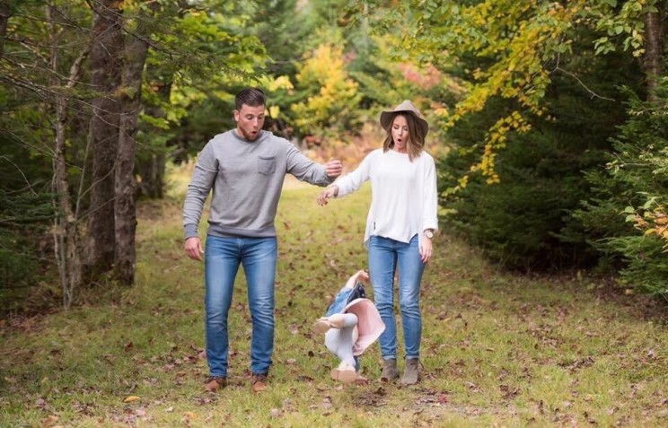 Well timed photo of parents dropping baby