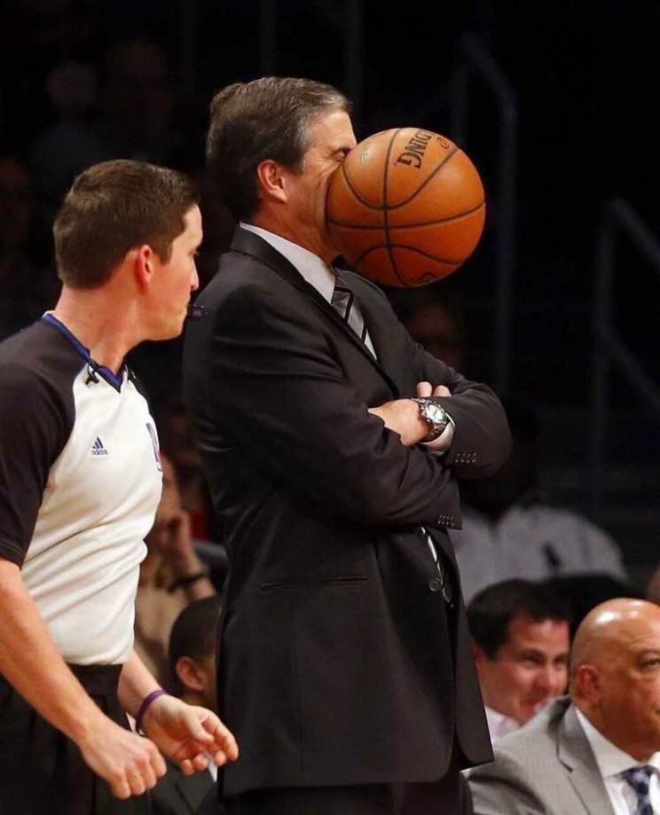perfectly timed photo of basketball hitting face