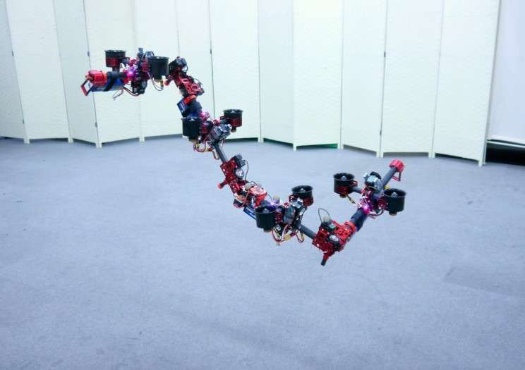 This Flying Robot Can Transform Itself to Pass Through Complex Spaces
