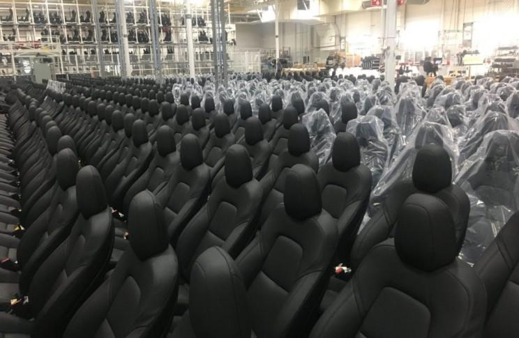 """Elon Musk Tweets Image of Model 3 """"Sentient"""" Seats in Factory"""