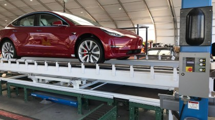 "Elon Musk Reveals Image of First Dual-Motor Model 3 Inside Tesla's New ""Tent"""