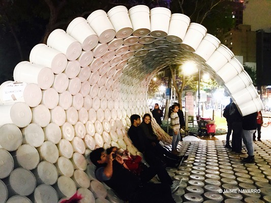 This Moveable Structure Made Out Of Buckets Carries A Vital Message