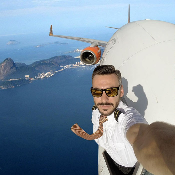 This pilot and well-known Instagrammer is coming under fire for taking shocking selfies mid-flight.