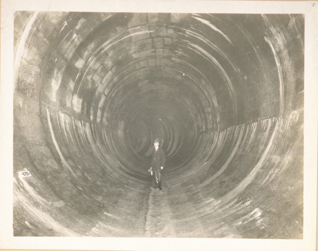 the-catskill-aqueduct-tunnels-are-30-feet-across-at-their-widest-points--enough-to-make-men-standing-inside-them-look-tiny