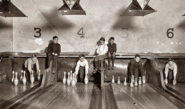 18. Before automatic pinsetters were invented, -pin boys- worked to manually line them up. (1914)