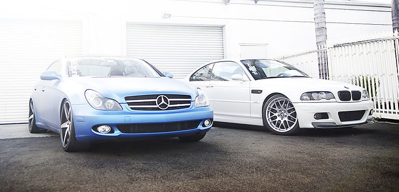 Matte_Blue_Mercedes_CLS550_and_White_BMW_M3_(12300639565)