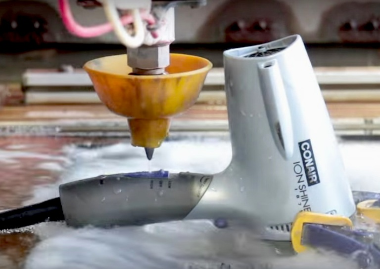 waterjet cuts hairdryer in half