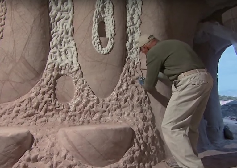 man digs caves sculpture