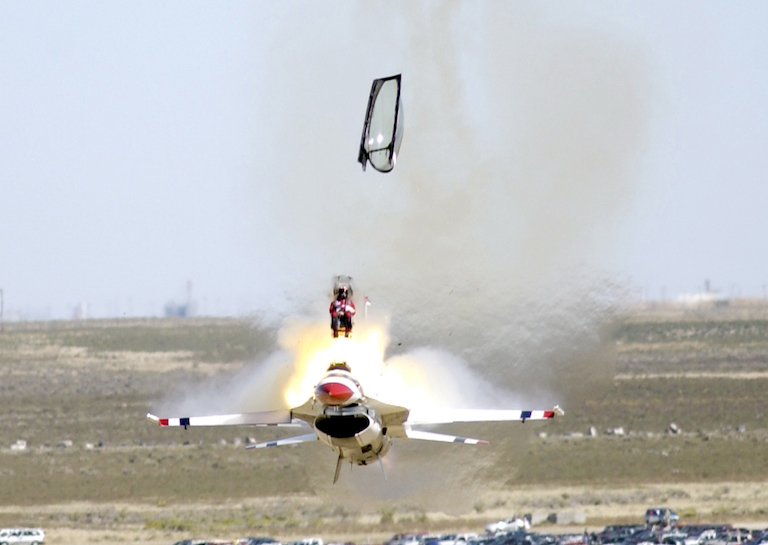MOUNTAIN HOME AIR FORCE BASE, Idaho -- Capt. Christopher Stricklin ejects from the USAF Thunderbirds number six aircraft less than a second before it impacted the ground at an air show at Mountain Home Air Force Base, Idaho, Sept. 14. Stricklin, who was not injured, ejected after both guiding the jet away from the crowd of more than 60,000 people and ensuring he couldn't save the aircraft. This was only the second crash since the Air Force began using F-16 Falcons for its demonstration team in 1982. The ACES II ejection seat performed flawlessly. (U.S. Air Force photo by Staff Sgt. Bennie J. Davis III)