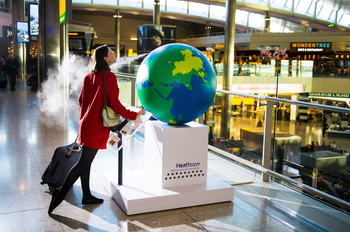 Tuesday 28th October 2014. Heathrow Airport, London: Heathrow brings to life global scents for passengers with a fragrant and interactive installation in Terminal 2 As they enter the departure lounge, travellers are confronted by the giant, one-of-a-kind 'scent globe' which will immerse the curious in the aromas of Thailand; South Africa; Japan; China and Brazil. This picture: Passenger Laura Greene from North London tries out the installation For more information, please contact Surname & Surname on +44 (0)207 260 2770 or email heathrowteam@thisissurname.com. PR Handout Copyright: © Mikael Buck / Heathrow +44 (0) 782 820 1042 http://www.mikaelbuck.com