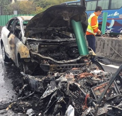Tesla Model X car left in burnt debris after being in flames