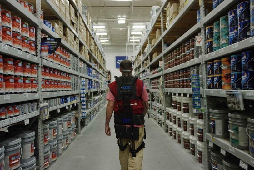 Store associate wearing an exosuit