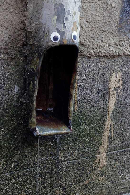 Street pipe with googly eyes