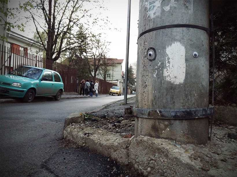 Street post with googly eyes