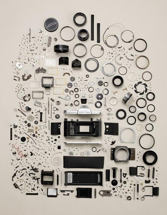 Disassmbled old camera neatly arranged