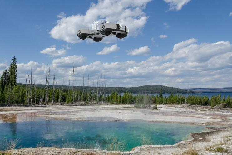 The AirQuadOne flying above water