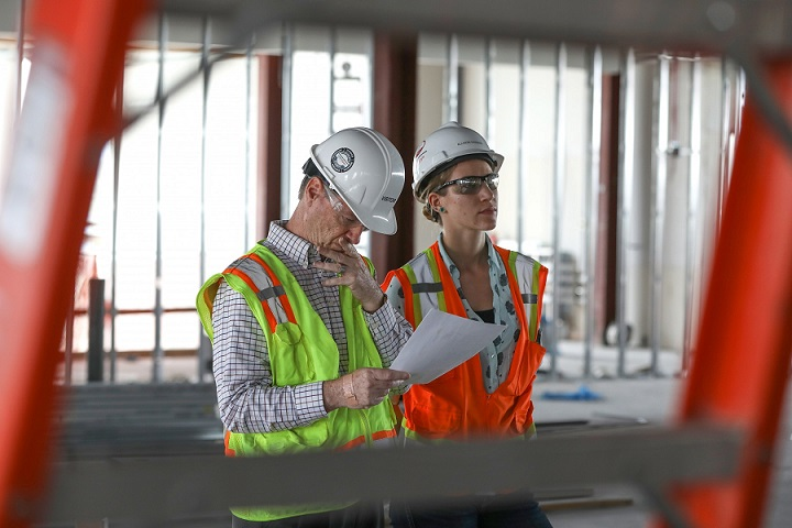 Allison Kassian on site with an engineer