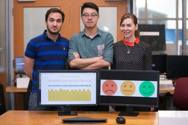 MIT researchers with their EQ-Radio device