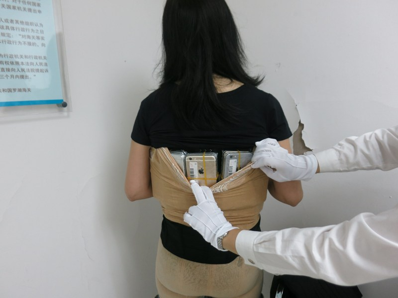 This Chinese Smuggler Got Caught with 102 iPhones Strapped to Her Body