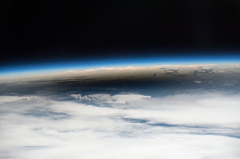 NASA Photographer Captures the Incredible Moment the ISS Flies Across the Solar Eclipse