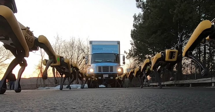 Watch 10 Boston Dynamics Robo-Dogs Pull a Truck in a Parking Lot