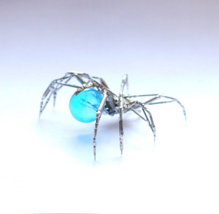 The Watch Spider is made from parts of an old watch