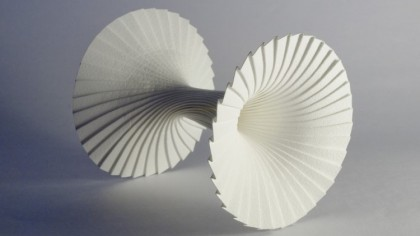 Modular paper sculptures intricately formed by artist