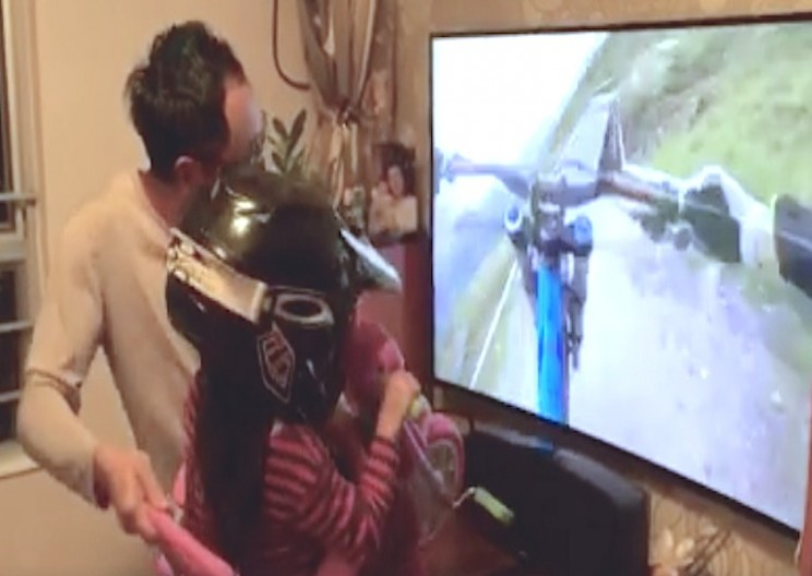 Watch this Dad Simulate Mountain Biking for His Daughter
