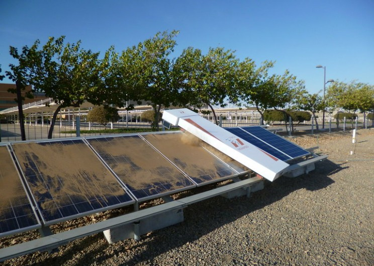 Keeping desert solar power arrays free of dust