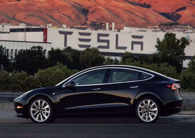 Elon Musk Reveals Photos of First Production Tesla Model 3