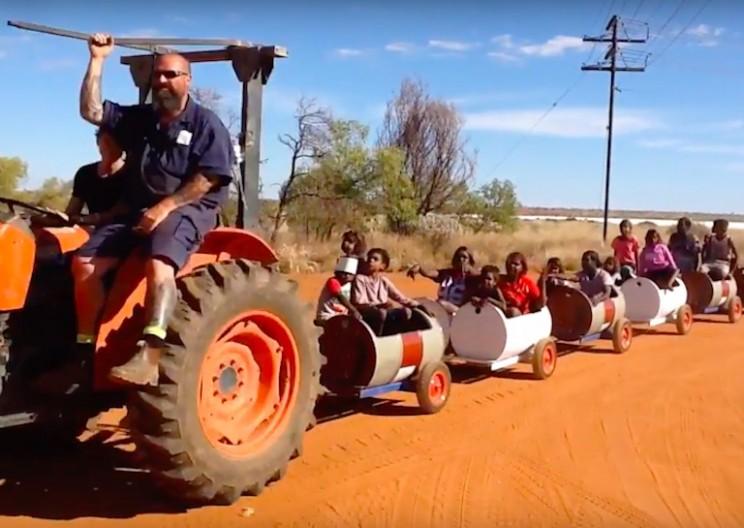 This DIY Barrel Train Ride Encourages Children to Go to School
