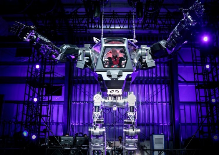 Amazon CEO Jeff Bezos Tests out a Massive Mechanical Robot Suit