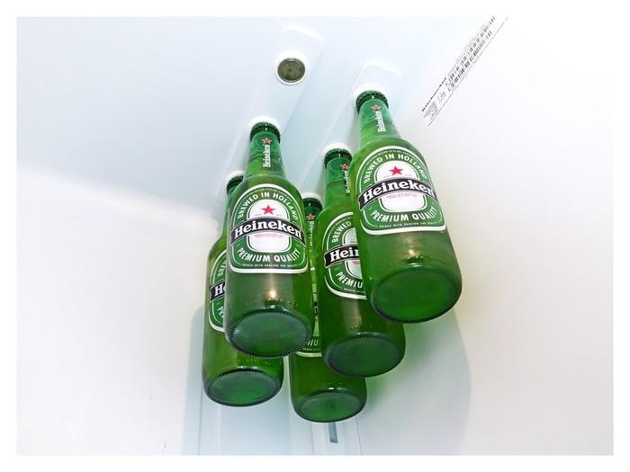 The BottleLoft sticks your beer to the fridge ceiling, freeing up shelves