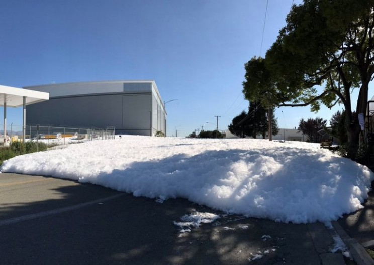 Wall of Foam from Airport Floods into a California Street
