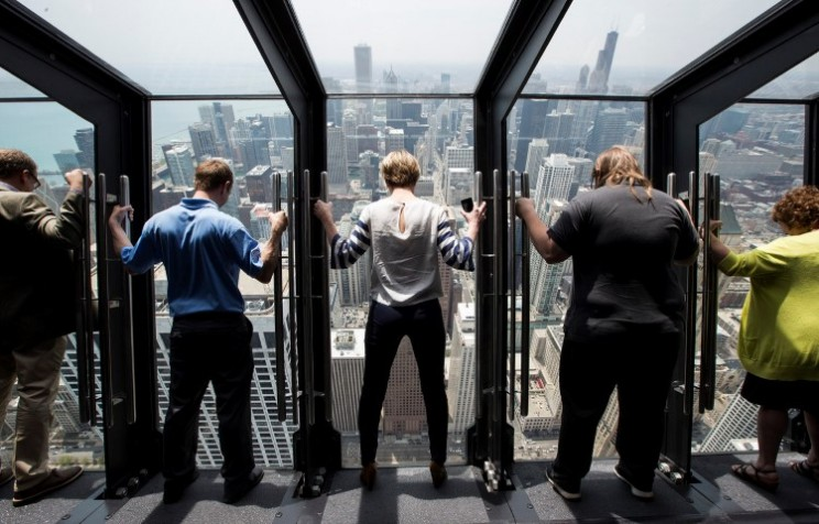 The John Hancock Observatory aka 360 Chicago Tilt will have you on edge