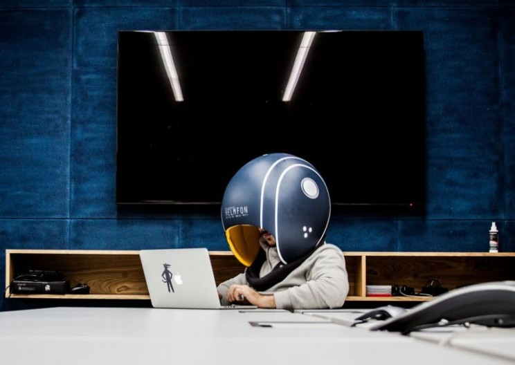 This Isolation Helmet Completely Blocks Out Workplace Distractions