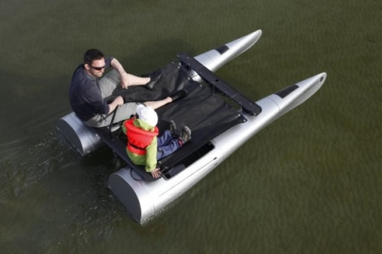 Backyak is a Modular Sailboat, Sled and Kayak in a Backpack