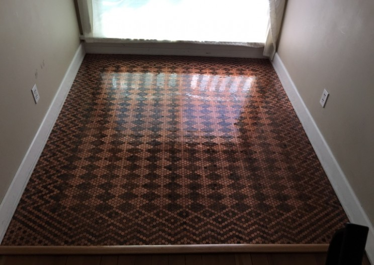 Woman Uses Pennies to Tile Her Floor into Neat Patterns