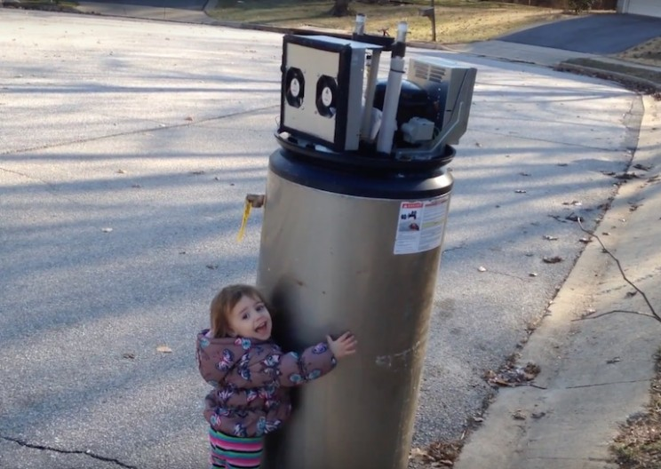 Adorable Little Girl Mistakes An Old Water Heater For A Robot