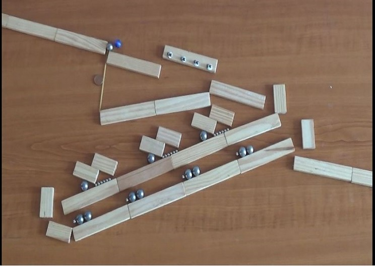 Ingenious Rube Goldberg Machine Made from Marbles and Magnets