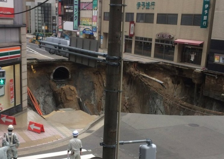 Sinkhole swallows Japanese intersection whole