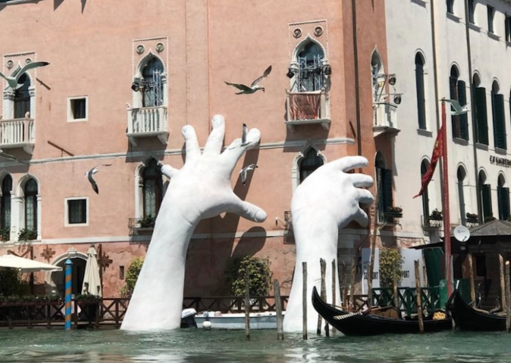 Artist Installs Giant Hand Sculptures in Venice Canal to Highlight Climate Change