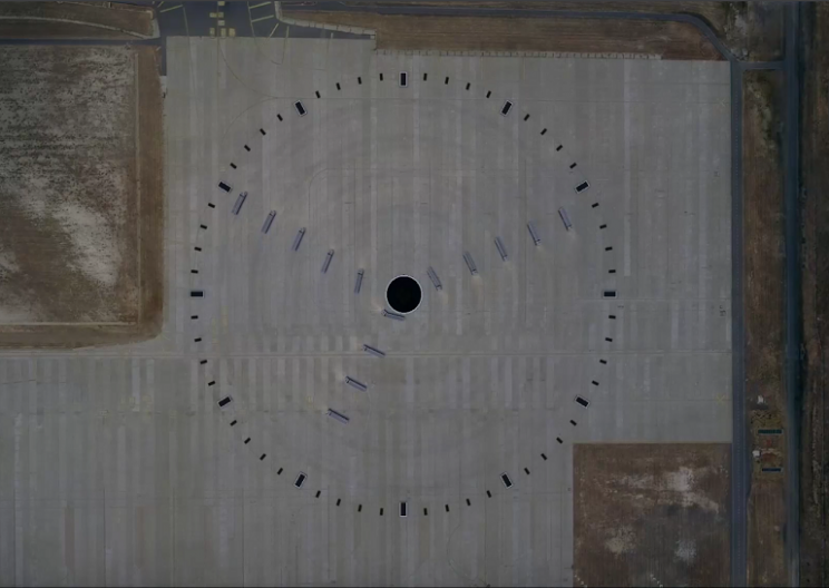 14 Trucks Work in Unison to Make a Giant Clock